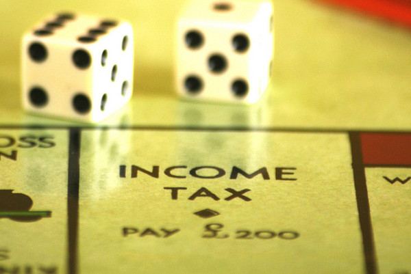 income tax monopoly dice debt