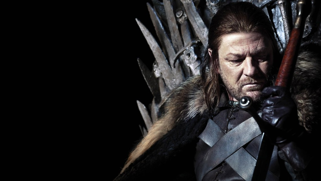 Sean Bean as Ned Stark on Game of Thrones looking down sitting on his throne