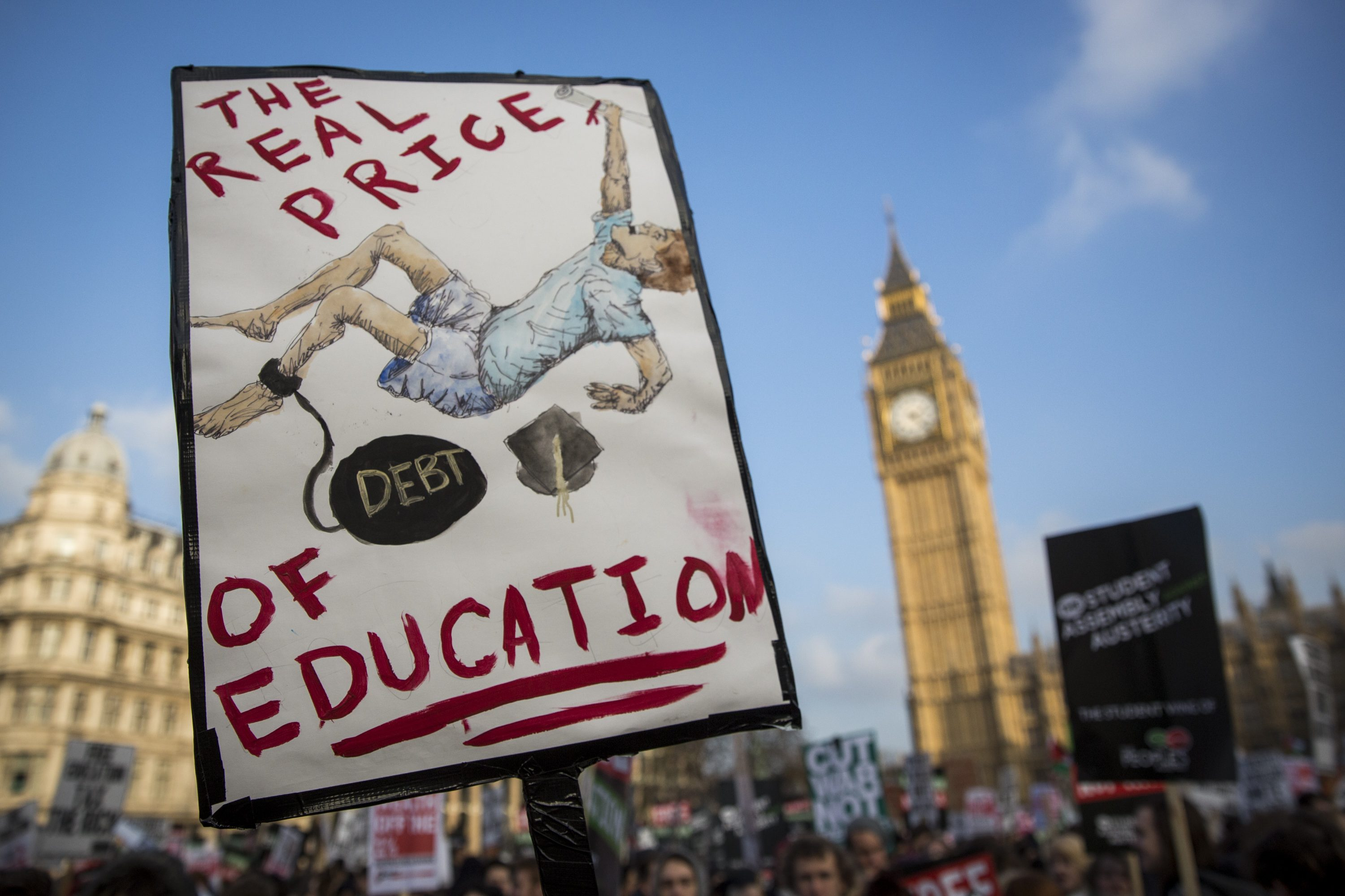 Protesters gather in Parliament Square during a march against student loans in London