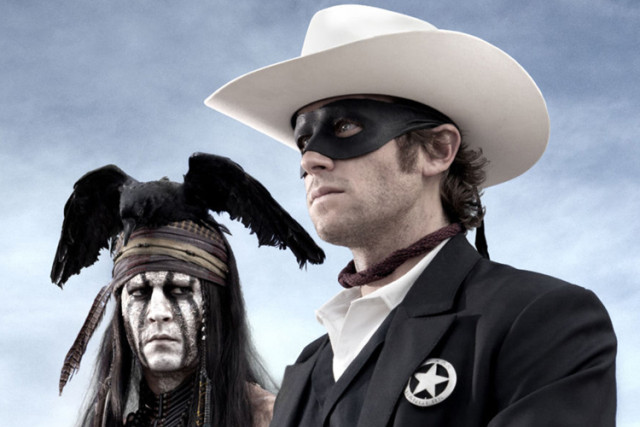 Johnny Depp and Armie Hammer looking forward with blue sky behind them in the Lone Ranger