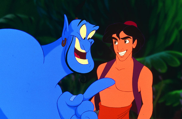 The Genie pointing and laughing at Aladdin, who smiles and stares back at him.