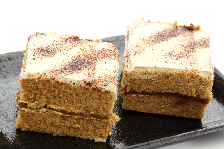 Tiramisu cake with a cheesecake coating