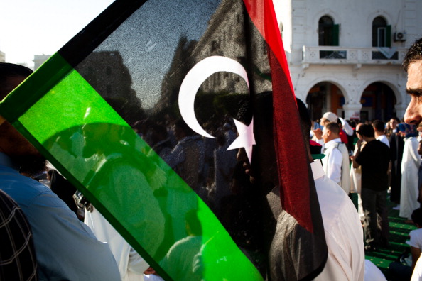 The Libyan flag is seen among a crowd