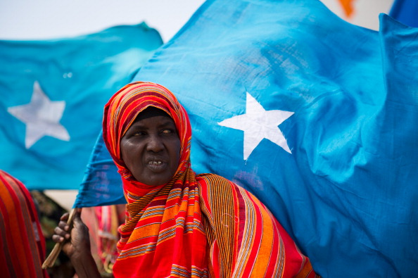 A woman holds the Somali flag