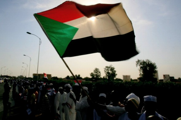 The Sudanese flag waves in the sun