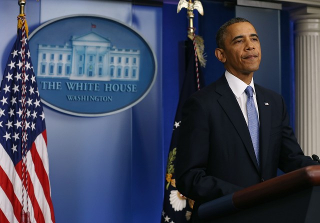 Obama standing at the podium in Washington