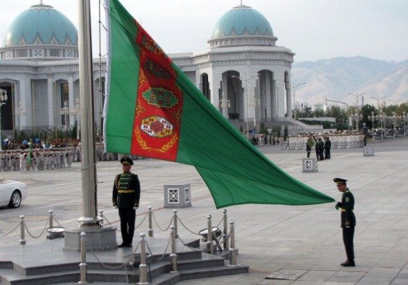 Soldiers raise the flag in Turkmenistan