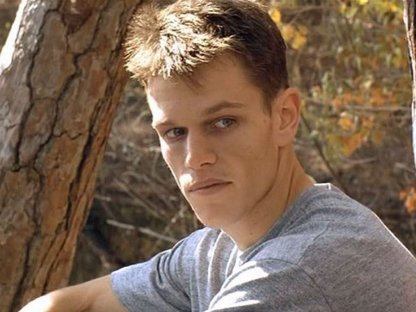 A young Matt Damon in a grey tshirt, looking to the right of the frame
