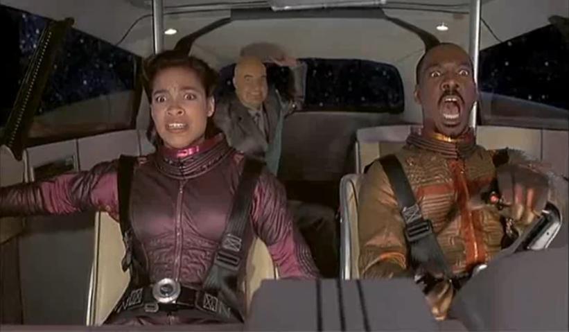 Eddie Murphy and Rosario Dawson in the Adventures of Pluto Nash