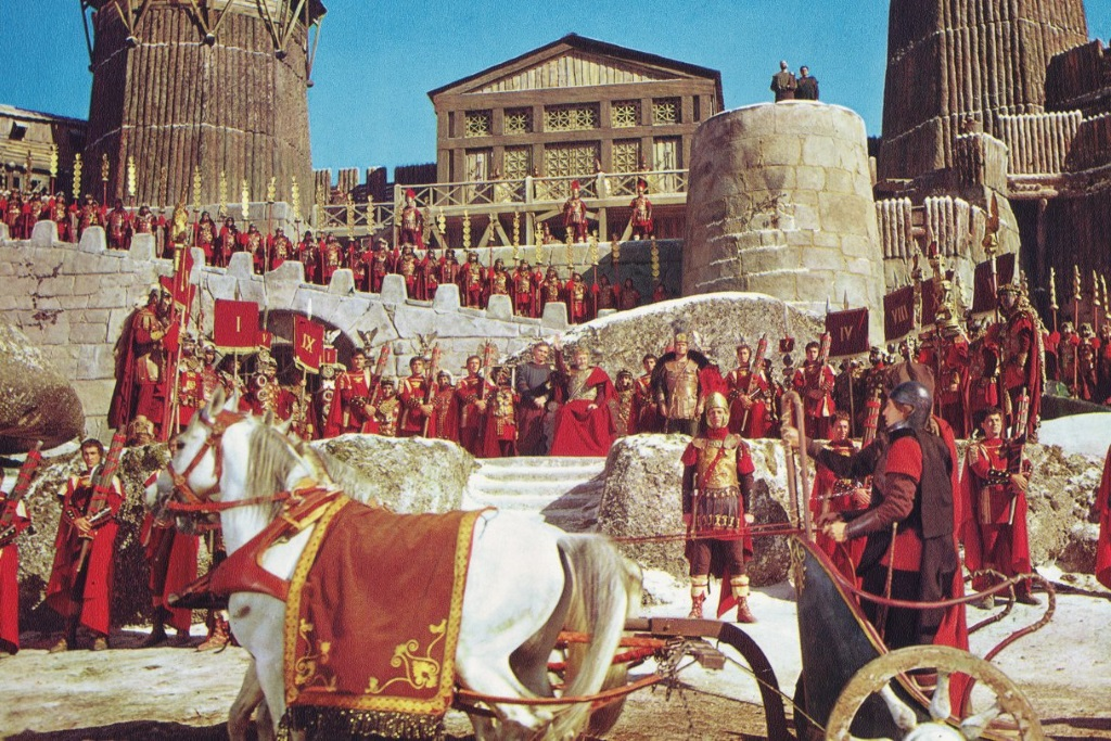Roman soldiers gather on the steps of a building in The Fall of the Roman Empire