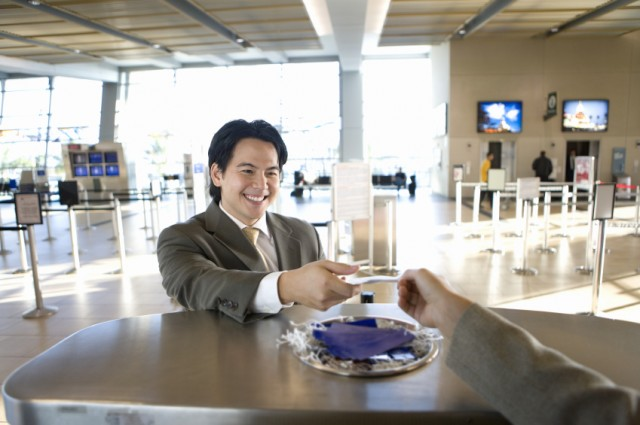 Businessman receiving airplane boarding pass