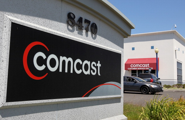 A Comcast sign outside of a retail store