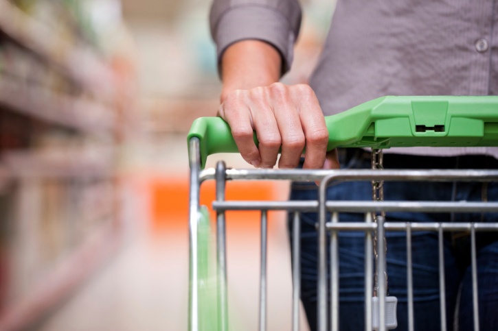 A woman walks with her shopping cart