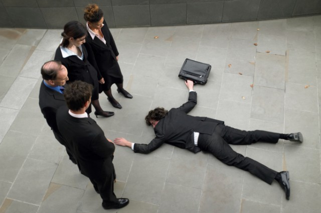 Worker lying on ground
