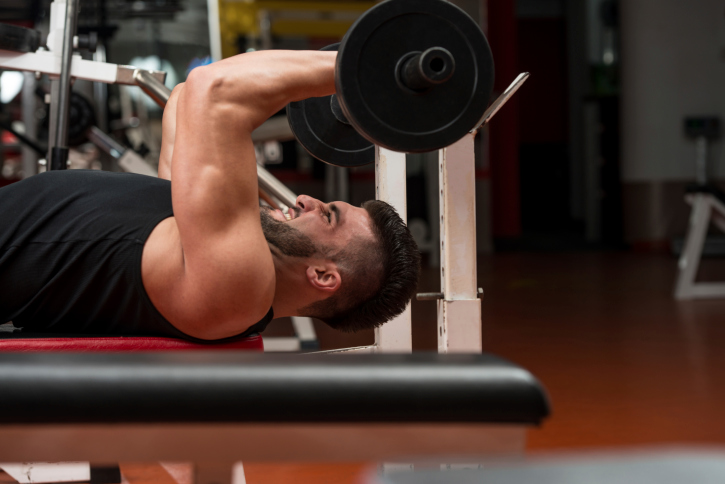 man lifting weights at the gym as an exercise alternative