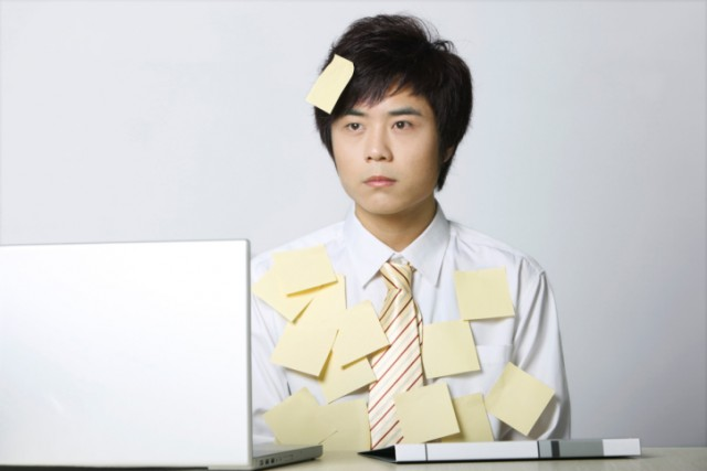 man covered in post-its