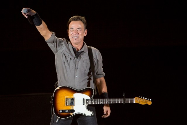 Bruce Springsteen on stage with his guitar