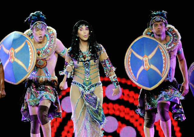 Cher performing in costume