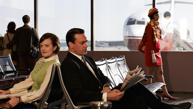 Peggy and Don sit in an airport in a promotional image for the seventh season of 'Mad Men'