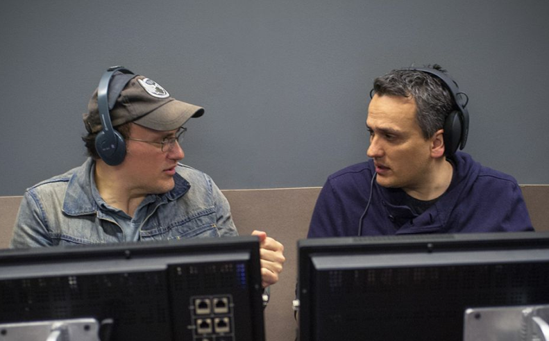 Joe and Anthony Russo sit at computers