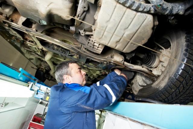 car mechanic wheel alignment