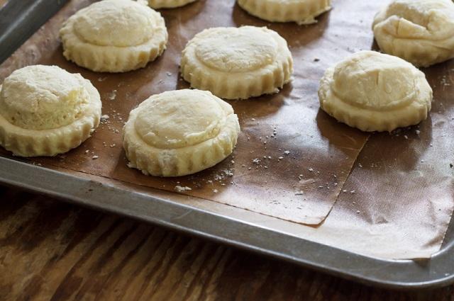 stuffed pies on a baking sheet