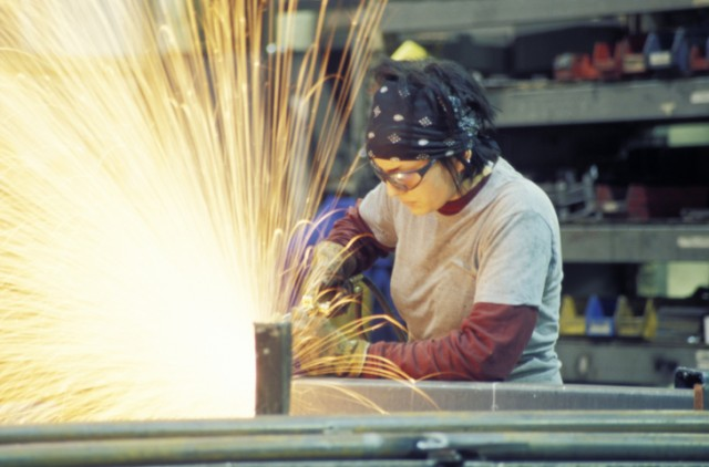 A middle class worker toiling away in a fabrication shop