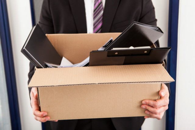 Businessman with box of belongings from work