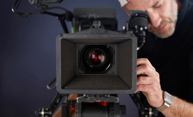 A man records with a video camera