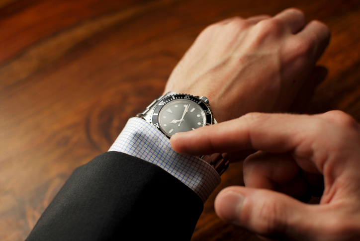 Man touching watch
