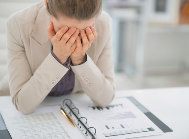 woman looking frustrated at work