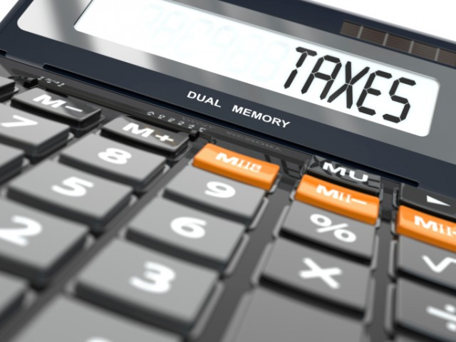 A calculator spelling out taxes