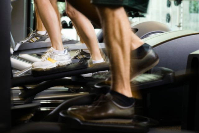 People use elliptical machines