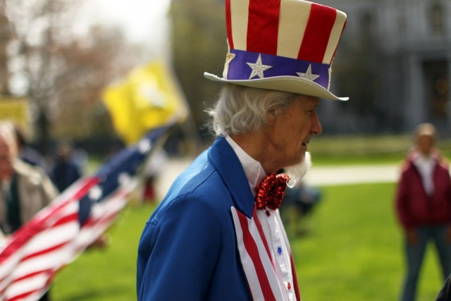 A participant dressed as Uncle Sam attends a Tea Party Express rally on April 13, 2010 in Albany, New York. The Tea Party Express will head to Boston on Wednesday where the headline speaker at an afternoon rally will be Sarah Palin.The group will conclude its national tour in Washington, D.C. Thursday with a Tax Day rally at the Washington Monument. (Photo by Spencer Platt/Getty Images)