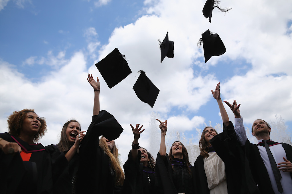 Students throw their caps in the air ahead of their graduation ceremony at the Royal Festival Hall on July 15, 2014 in London, England. Students of the London College of Fashion, Management and Science and Media and Communication attended their graduation ceremony at the Royal Festival Hall today. (Photo by Dan Kitwood/Getty Images)