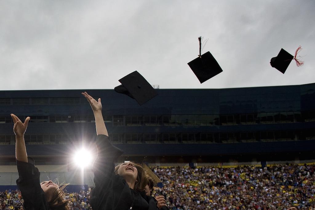 Graduates throw their caps in the air