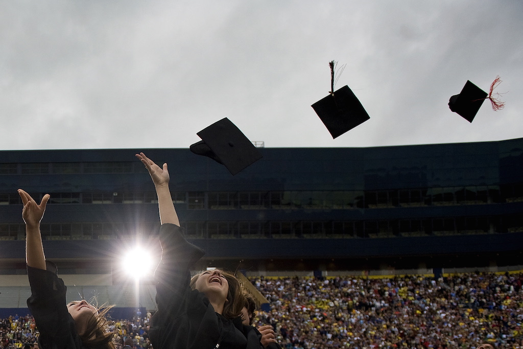 Graduates through their mortat boards in the air after US President Barack Obama delivered the commencement address at the University of Michigan in Ann Arbor, Michigan, May 1, 2010. (Photo by Jim Watson/AFP/Getty Images)