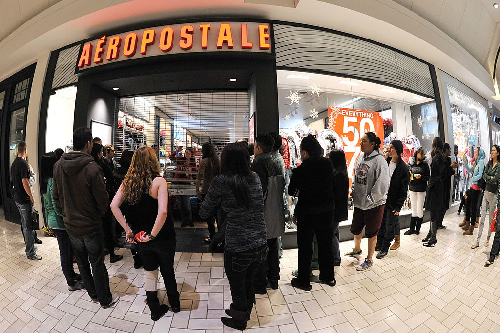 Shoppers wait for an Aeropostale store to open on November 26, 2010, at the Tyson's Corner Center mall in Tyson's Corner, Virginia