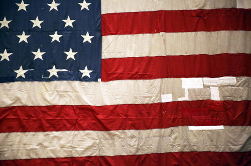 An American flag, often symbolic of the First Amendment