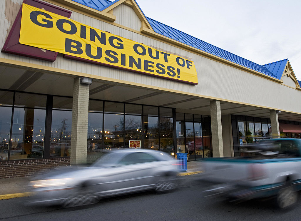 """A furniture store posts a """"Going Out of Business"""" sign"""