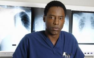 Isaiah Washington wearing a blue uniform in 'Grey's Anatomy'.