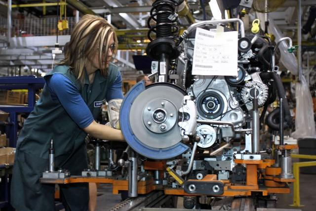 A worker builds an engine