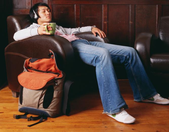 a man sitting in an armchair