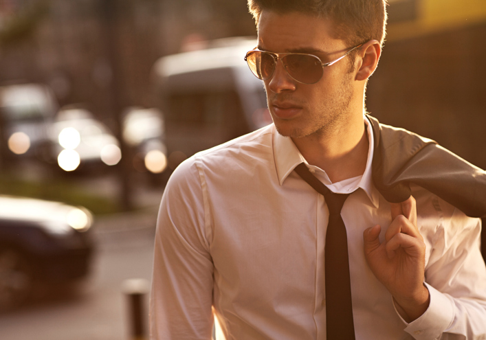 a man wearing a suit and sunglasses