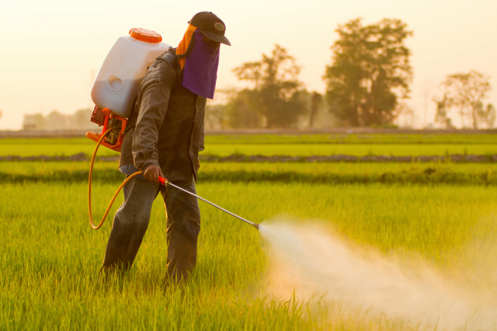 farmer spraying the fields with pesticides
