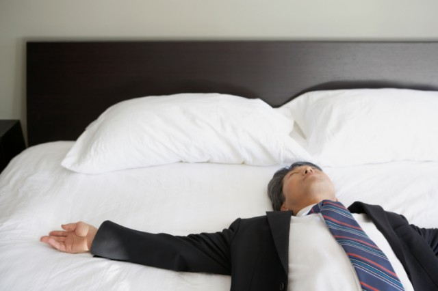 businessman trying to sleep