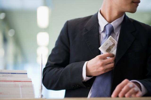 A shady businessman stealing money