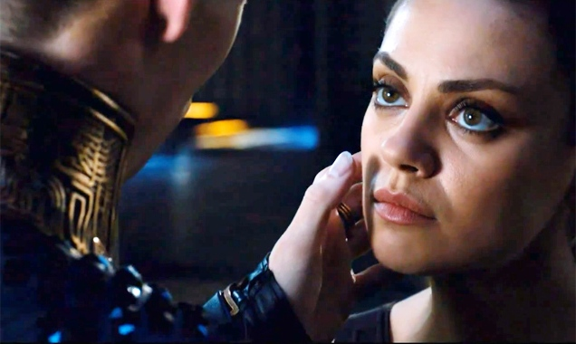 Mila Kunis looks up at a man in Jupiter Ascending