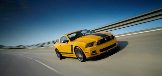 A yellow 2013 Ford Mustang Boss 302