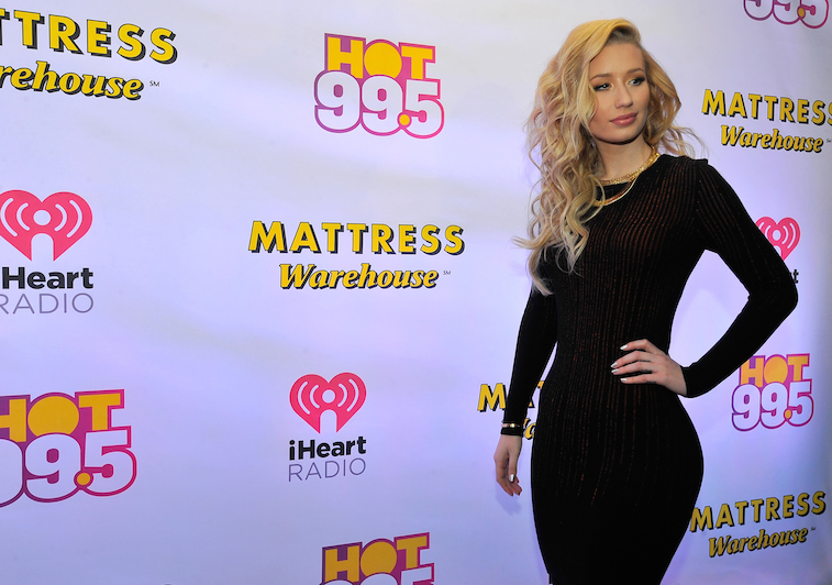 WASHINGTON, DC - DECEMBER 15: Iggy Azalea attends HOT 99.5ís Jingle Ball 2014, Presented by Mattress Warehouse at the Verizon Center on December 15, 2014 in Washington, D.C. (Photo by Larry French/Getty Images for iHeartMedia)